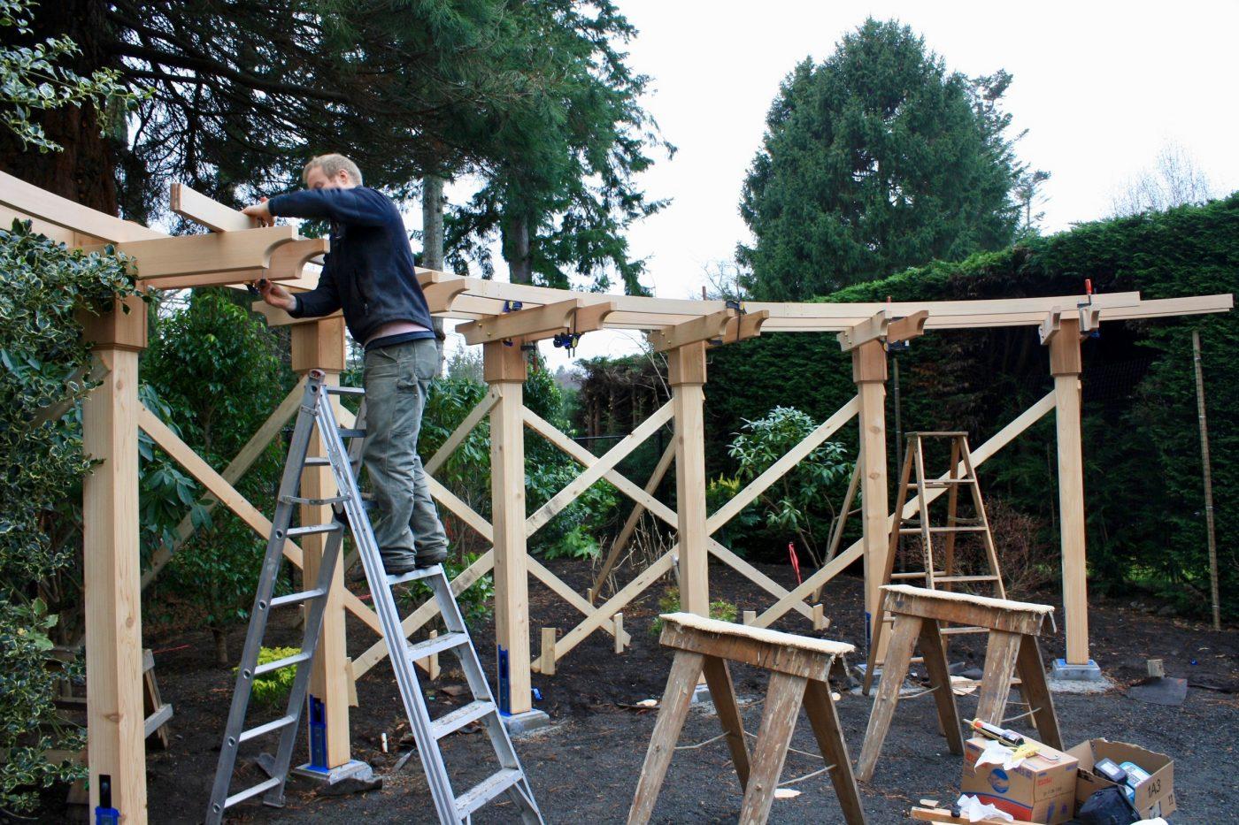 Curved cedar arbour under construction
