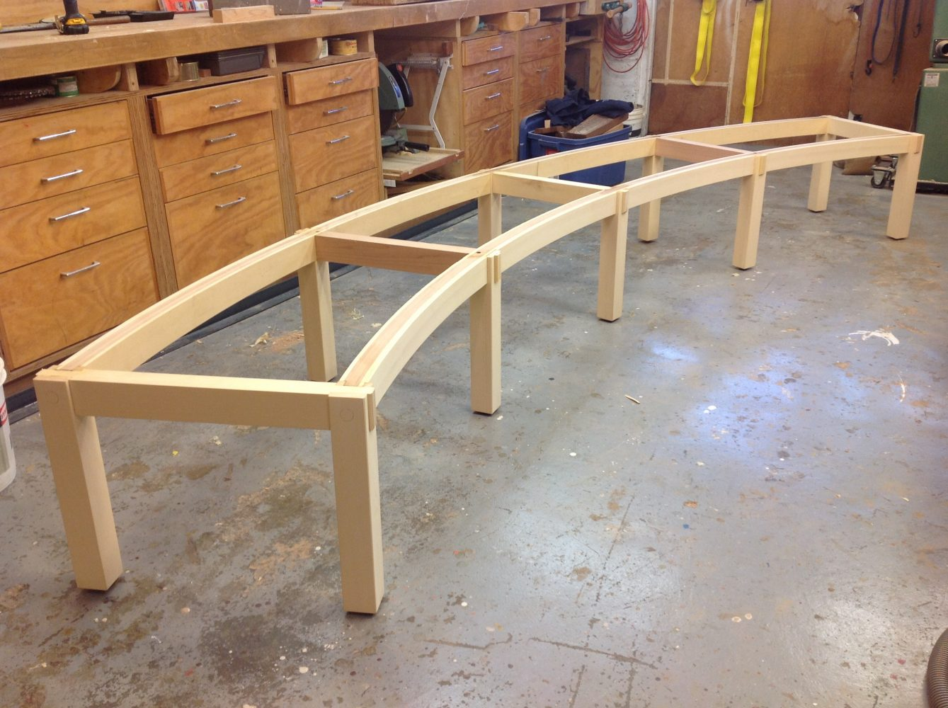 Curved garden bench construction