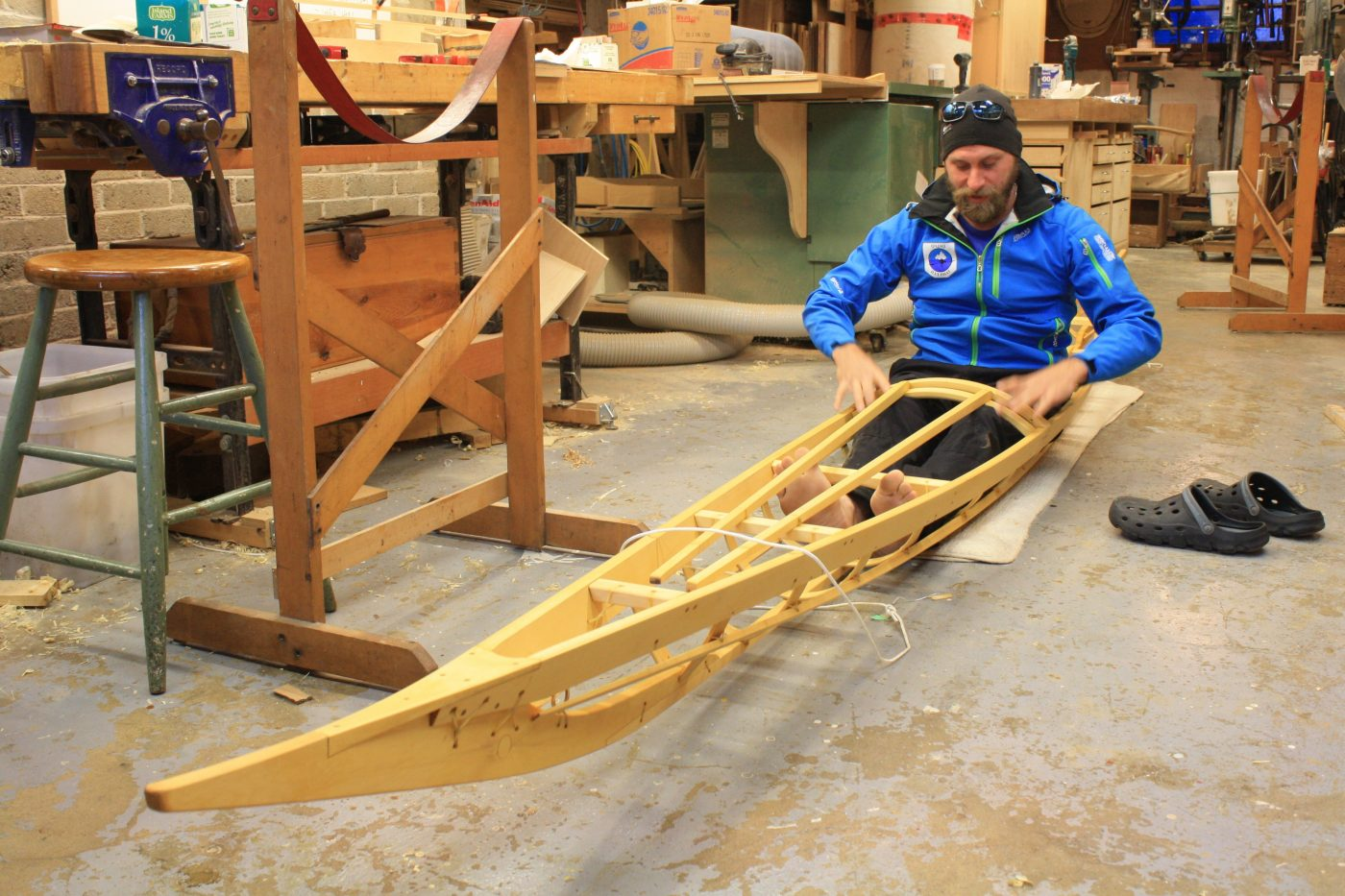 James Manke sitting in Tahe Greenland kayak frame