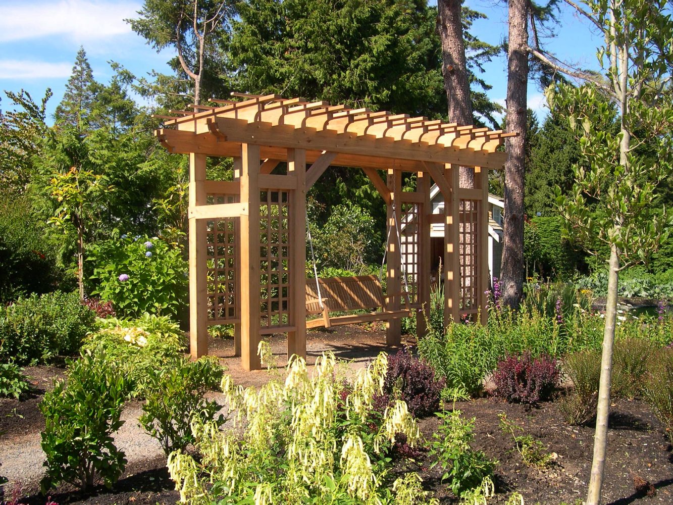 Cedar arbour with swing